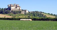 Impressive castle overlooking the fields near Parma