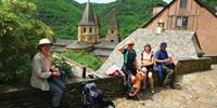 Walkers resting in Conques on the Way of St James, France