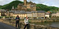 Walkers on the Way of St James, France, leaving Estaing