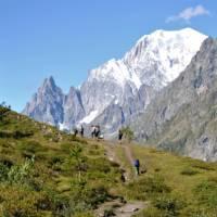 Group trekking along the Val Ferret balcony path | Ryan Graham