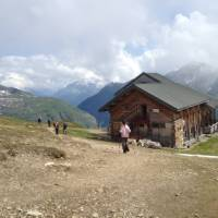 Hikers descending to the Bonhomme Refuge in the French Alps | Kate Baker