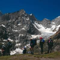 Trekkers on the crest of the Grand Col Ferret (2537m) on the Mont Blanc Circuit | Sue Badyari
