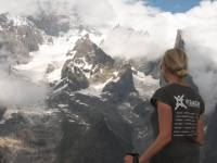 UTracks staff member on balcony trail overlooking Mont Blanc and glaciers Italy |  <i>Kate Baker</i>