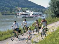 Family cycling along Danube