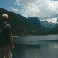 Hiker on Gosau Lake, Salzkammergut, Austria   Kate Baker