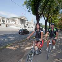 Cycling past Parliament in Vienna