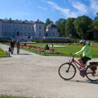Cycling past the palace in Palanga, Lithuania | Andrew Bain