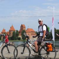 Cyclists in front of Trakai Castle, Lithuania