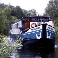 MS Mecklenburg sailing along a canal