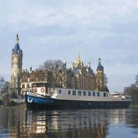 MS Mecklenburg sailing past a castle
