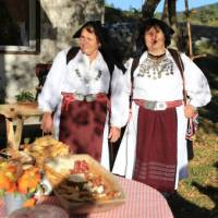 Villagers in traditional folk dress on the Via Dinarica trail