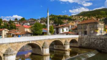 Experience the tranquil waterways of Sarajevo, Bosnia, while on the Via Dinarica