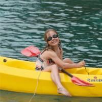 Child kayaking off the boat in the Mediterranean | Ross Baker