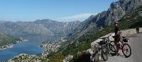 Cyclist pauses to admire the beauty of Kotor Bay, Montenegro