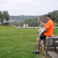 Cyclist enjoying a glass of wine in Istria