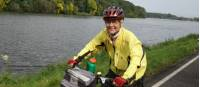 A happy cyclist following timeless river landscapes to Dresden