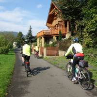 Cycling past traditional houses near Ústí nad Labem