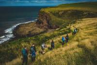 Walking single file along the green cliffs of England on the Coast to Coast |  <i>Tim Charody</i>