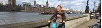 Cycling along the Thames Path in London with Big Ben and the Houses of Parliament in the background |  <i>Kate Baker</i>