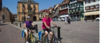 Cycling through a small village in Alsace