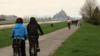 Cyclists and pedestrians en route to Mont St Michel | Kate Baker