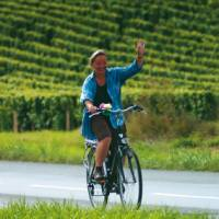 A local woman gives a welcoming wave, Loire Valley, France | Michael Gebicki