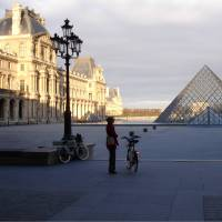 Cyclist at the Louvre in Paris | Kate Baker