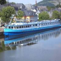 MS Patria moored on the river near to a picturesque town