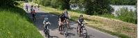 Family cycling along the Moselle Bike Path in Germany