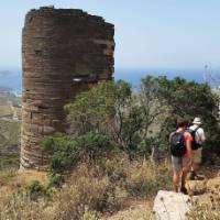 Hikers pass a Hellenistic Tower on the Andros Trail Self Guided Walk