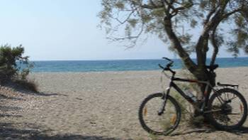 Taking a break from cycling at serene Kalavarda Beach in Greece