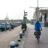 Cycling by the canal in Willemstad