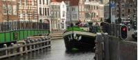 A barge with cyclists navigating the canals outside of Amsterdam |  <i>Richard Tulloch</i>