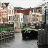 A barge with cyclists navigating the canals outside of Amsterdam | Richard Tulloch