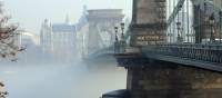 The Széchenyi Chain Bridge rises through the Autumn fog in Budapest