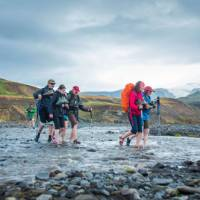 Crossing a river on the Laugavegur Trail in Iceland