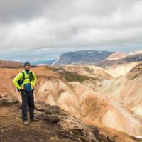 A hiker on the impossibly scenic Laugavegur Trail in Iceland