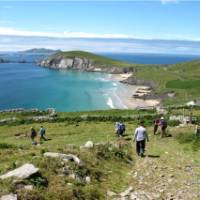 Hikers walking down to Coumeenoole Bay, Dingle