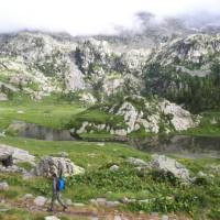 Walking past rugged mountainside on the Monte Rosa Alpine Walk
