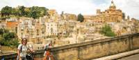 Cyclist with view to the historic heart of Caltagirone
