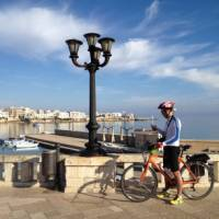 Cyclist on waterfront in Otranto   Kate Baker