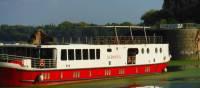 Ave Maria premium boat exterior docked in Mantova | Efti Poulos