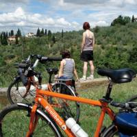 Cyclists taking in the Tuscan view