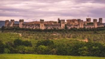 The walled town of Monteriggioni sits dramatically in the Tuscan landscape | Tim Charody