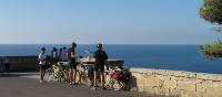 Cyclists above the point where the Ionian Sea meets the Adriatic Sea in Puglia | Kate Baker