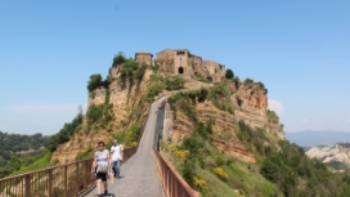 Hikers returning from the town of Civita di Bagnoregio