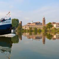 Travel past authentic Italian villages by bike or boat in the Veneto region