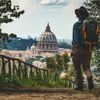 Pilgrim walking into St Peters in Rome at the end of the Via Francigena   Tim Charody