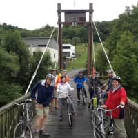 Cyclists on a bridge over the River Sauer in Luxembourg