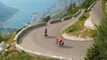 Cruising down the winding roads towards the Bay of Kotor on the Croatia to Albania Coastal Cycle